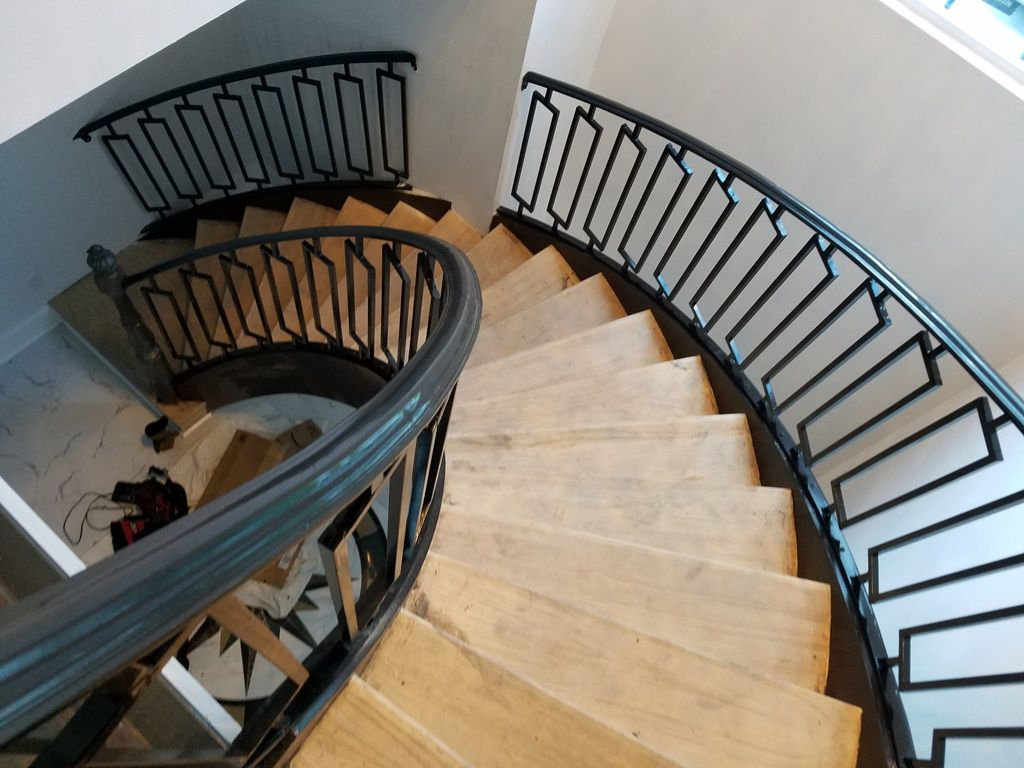 staircase brought iron railing